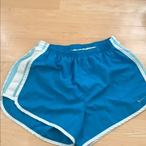 Blue striped nike running shorts